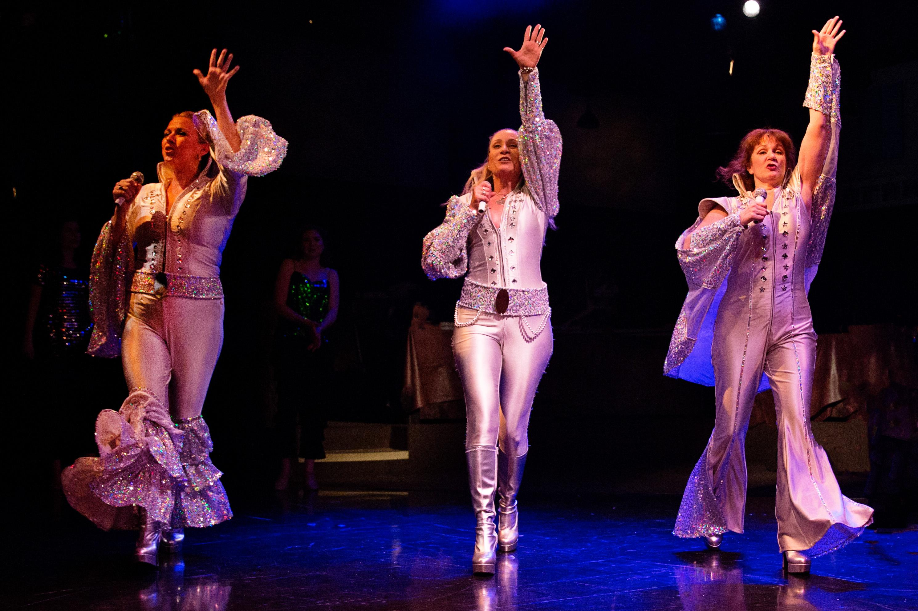 Coby Kay Callahan, Heather Marie Beck and Tess Rohan in MAMMA MIA! at Toby's Dinner Theatre.{ }(Image: Jeri Tidwell)