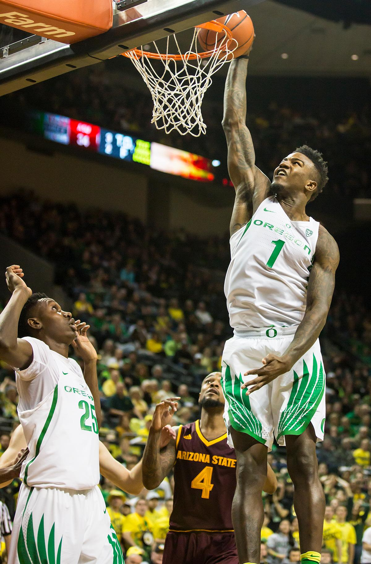 Oregon forward Jordan Bell (#1) leaps to dunk the ball as Oregon's Chris Boucher (#25) and Arizona State's Torian Graham (#3) watch. The Oregon Ducks defeated the Arizona State Sun Devils 71 to 70. Photo by Ben Lonergan, Oregon News Lab