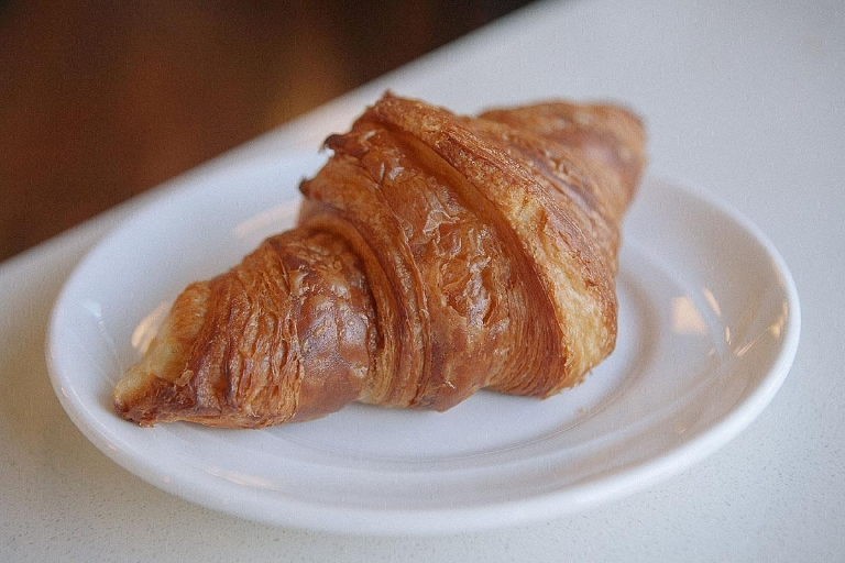 This croissant has an amazing amber color and an incredibly crunchy outside. (Image: Jenny Kuglin / Seattle Refined)