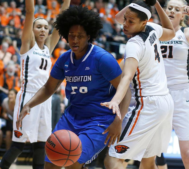 Creighton's Brianna Rollerson (50) and Oregon State's Breanna Brown reach for a loose ball during the first half of a second-round game in the NCAA women's college basketball tournament Sunday, March 19, 2017, in Corvallis, Ore. (AP Photo/Timothy J. Gonzalez)