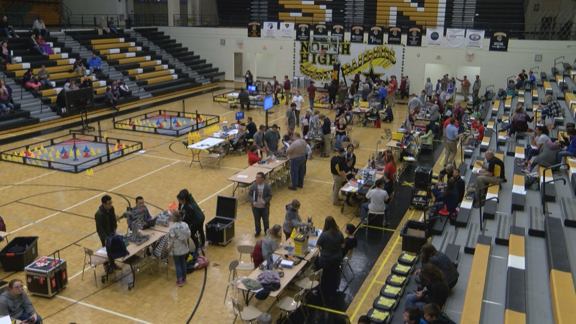 "Competitors readied their robots for inspection by a group of judges before the competition began. Each robot must fit within an 18"" x 18"" x 18"" space, but can expand to become larger during matches. (Thomas Gray/WCYB)"