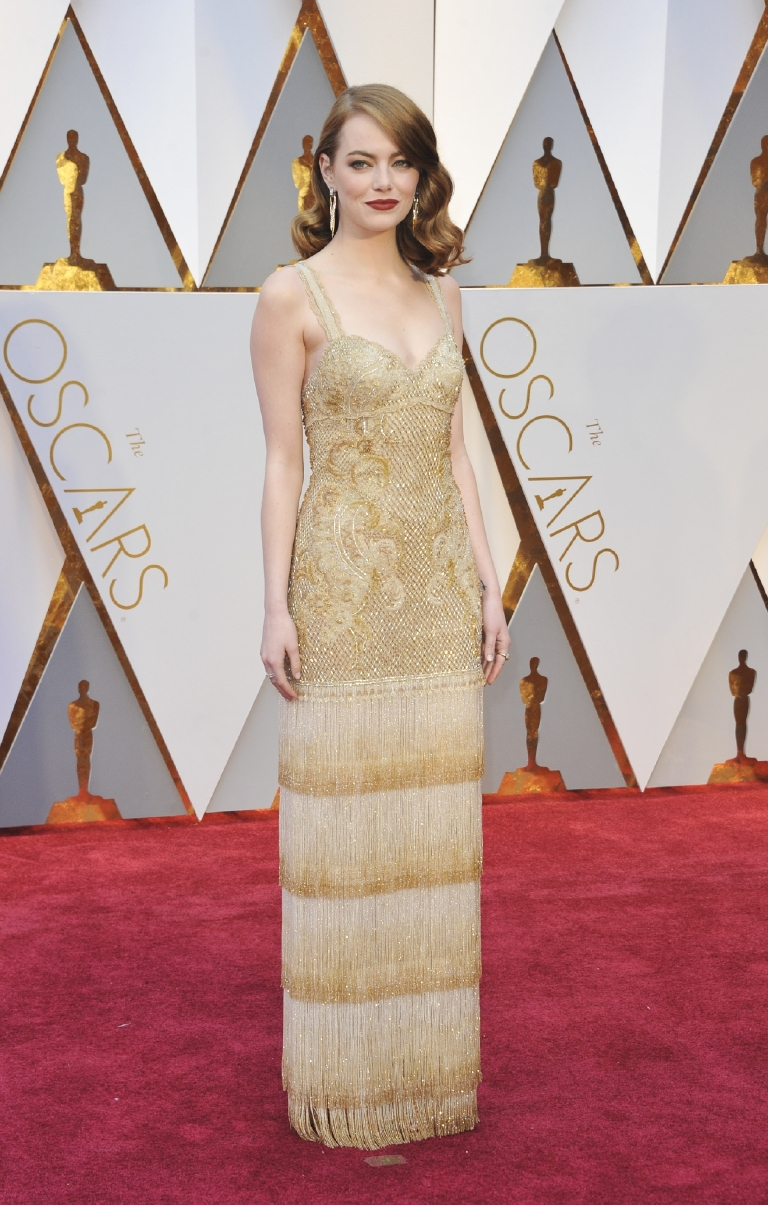 I'll probably get some hatred on this one, but I find this dress to be pretty blah. The fringe doesn't mix with the top of the dress to me. (Image: Apega/WENN.com)