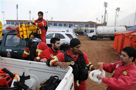 Rescue personnel get ready to go into action in the northern town of Iquique, Chile, after magnitude 8.2 earthqauke struck the northen coast of Chile, Wednesday, April 2, 2014.