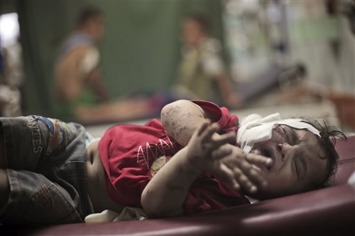 A Palestinian boy cries while receiving treatment for injuries caused by an Israeli strike at a U.N. school in Jebaliya refugee camp.