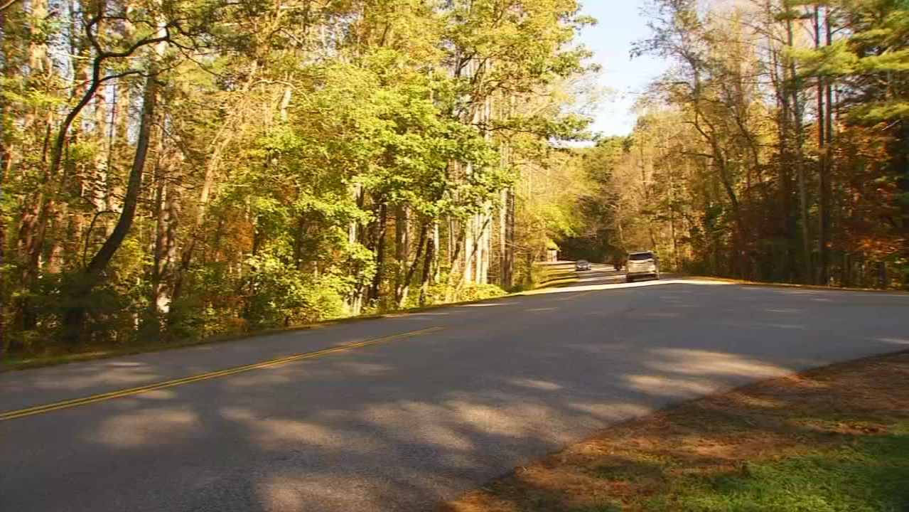 Visitors to the Blue Ridge Parkway bring nearly $1 billion a year to local economies but also contribute to increased deterioration of natural resources in the area, not just to roads and facilities. (Photo credit: WLOS staff)