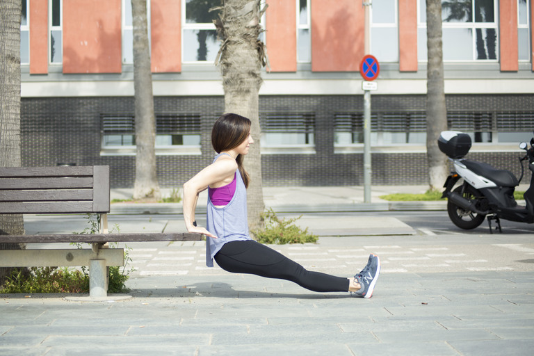 If you're outside for this workout, use a park bench for your tricep dips. (Image:  Andrea Kay Images)<p></p>