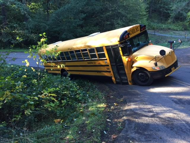 A school bus was forced off the road on Northeast Corral Creek Road Tuesday as a big rig drove by. (Photo: Brad Spring)<p></p>