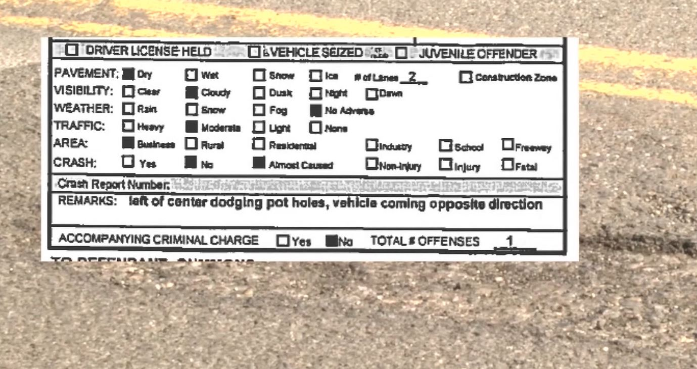 A Canton woman was ticketed by an Ohio State Trooper for swerving left of center to dodge potholes (Courtesy: CNN Newsource)