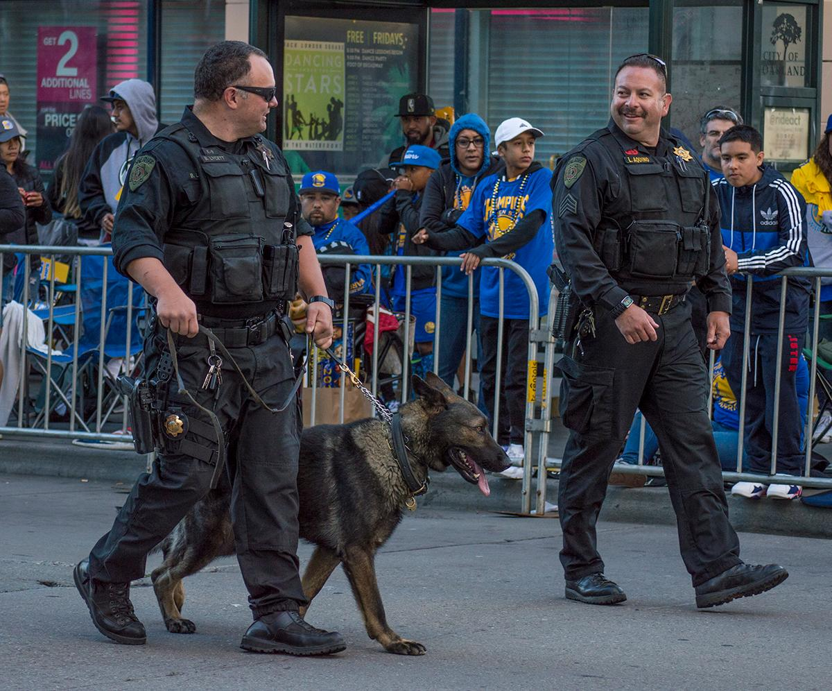 There was police presence at the Golden State Warriors victory parade. Two bomb squad officers and a K-9 patrol the crowd. Photo by Emily Gonzalez, Oregon News Lab.