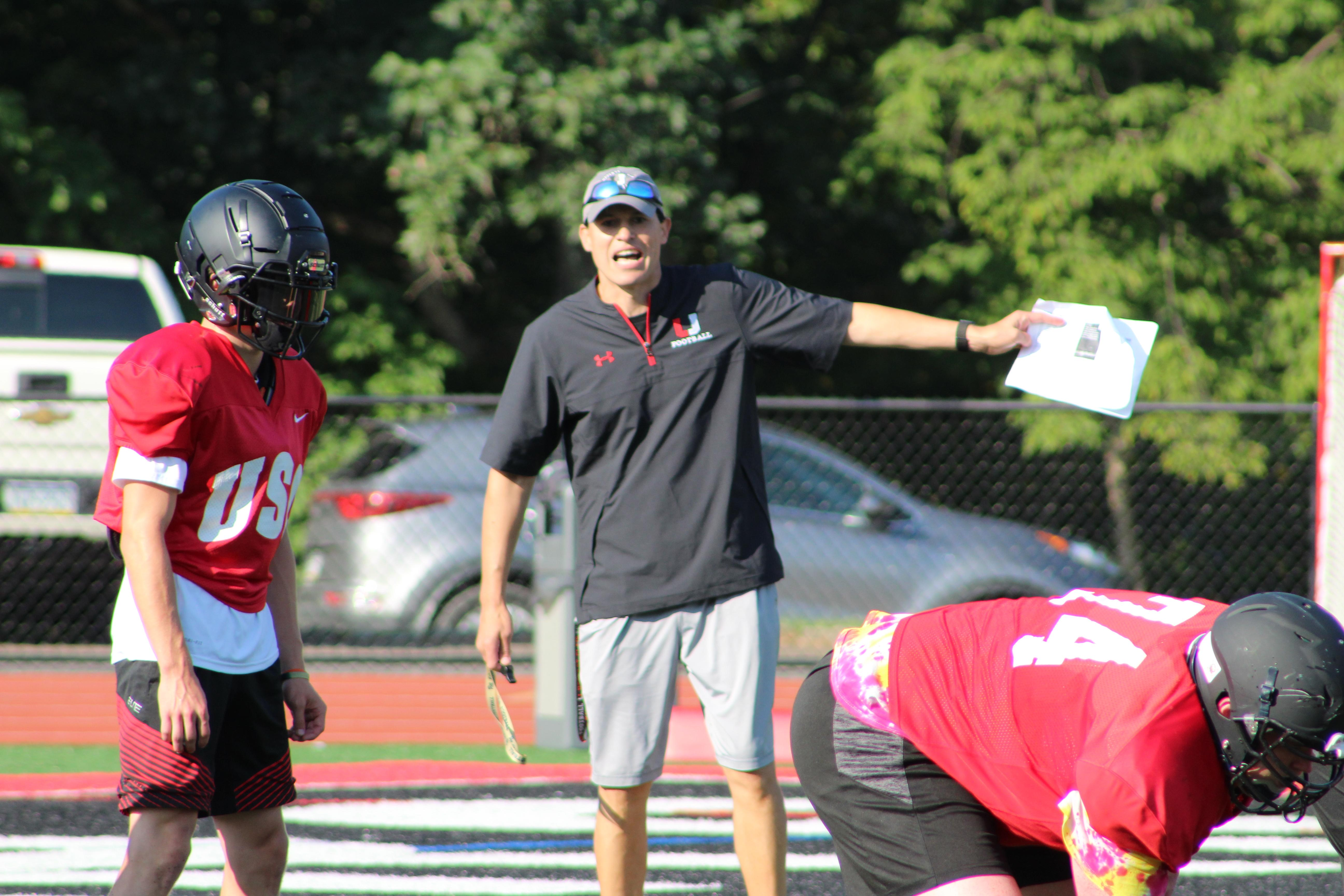 "New Upper St. Clair Head Coach Mike Junko instructs the offense during an August practice. Watch the AHN Friday Night Rivals powered by IGS Energy ""Kickoff Special"" Aug. 23 at 7 p.m. on 22 the Point.{ }"