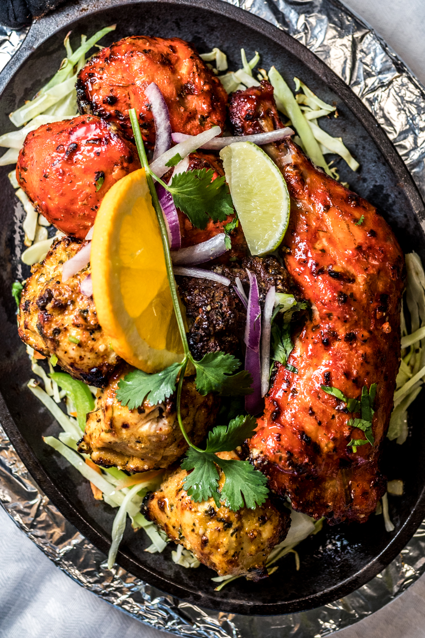 Non-Veg Platter: Tandori chicken, malai tikka, chicken tikka, and lamb chops served on a sizzler hot plate with two kinds of chutneys and naan bread / Image: Catherine Viox // Published: 2.6.20