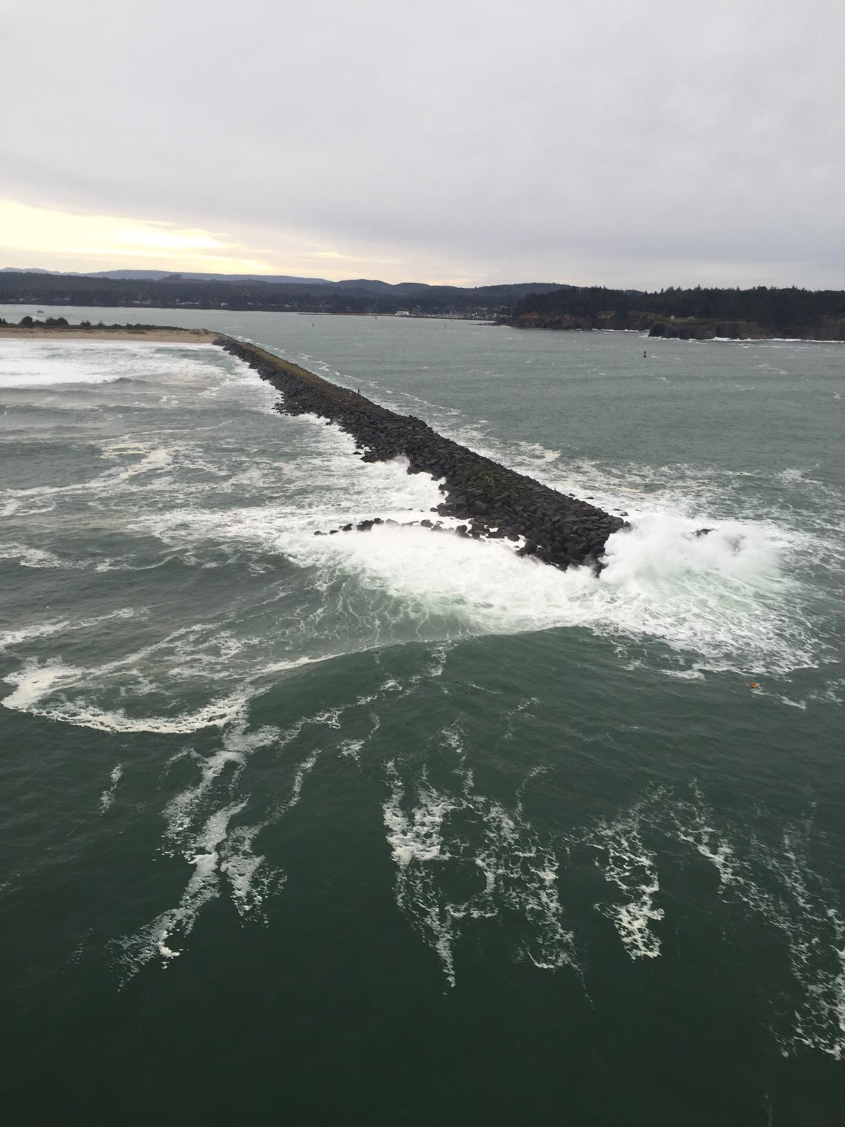 The North Jetty near Coos Bay, Ore., is pictured after crab fishing vessel Eagle III broke up, Jan. 20, 2016. The debris field congregated along the north side of the North Jetty, with some debris migrating with the tide across the bar and into the river. (U.S. Coast Guard photo courtesy Air Station North Bend)