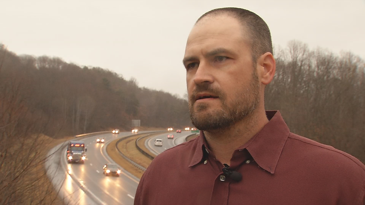 David Gibson said his wife was driving westbound on Interstate 40 about 10:20 p.m. Tuesday and, when she passed the North Luther Road overpass, someone dropped a brick and hit her car. (Photo credit: WLOS staff)