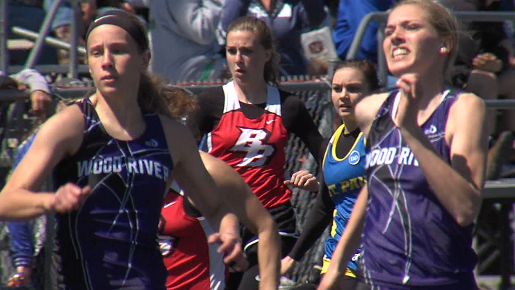 Emily Loy (left) and Jocelyn Rauert, both of Wood River, race in the girls 100 meter dash at the Ron Priebe Invite in Gibbon, April 20, 2017.  Rauert won the race (NTV News)