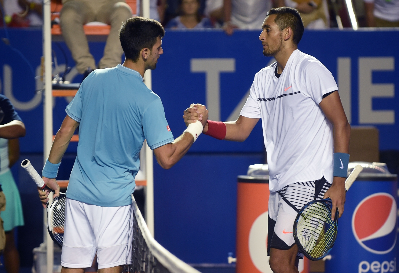 Australia's Nick Kyrgios (R) speaks to Serbia's Novak Djokovic (L) after winning his match during the fourth day of the Mexican Tennis Open, in Acapulco, Guerrero State, Mexico, on March 3, 2017. / AFP PHOTO / ALFREDO ESTRELLA        (Photo credit should read ALFREDO ESTRELLA/AFP/Getty Images)