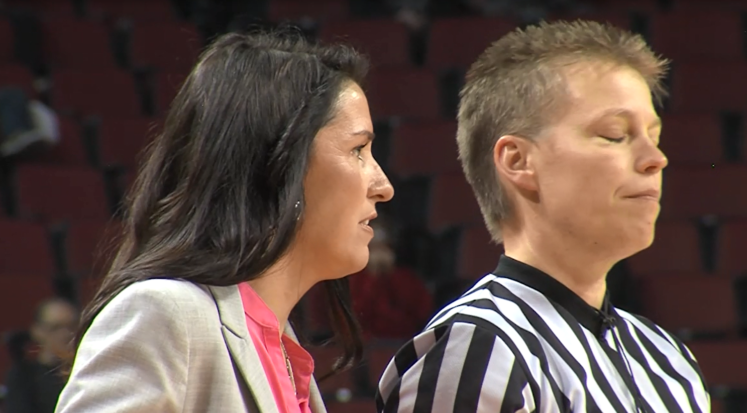 Nebraska head coach Amy Williams (left) speaks with an official as the Huskers women's basketball team takes on Colorado State, Nov. 17, 2016 (KHGI)