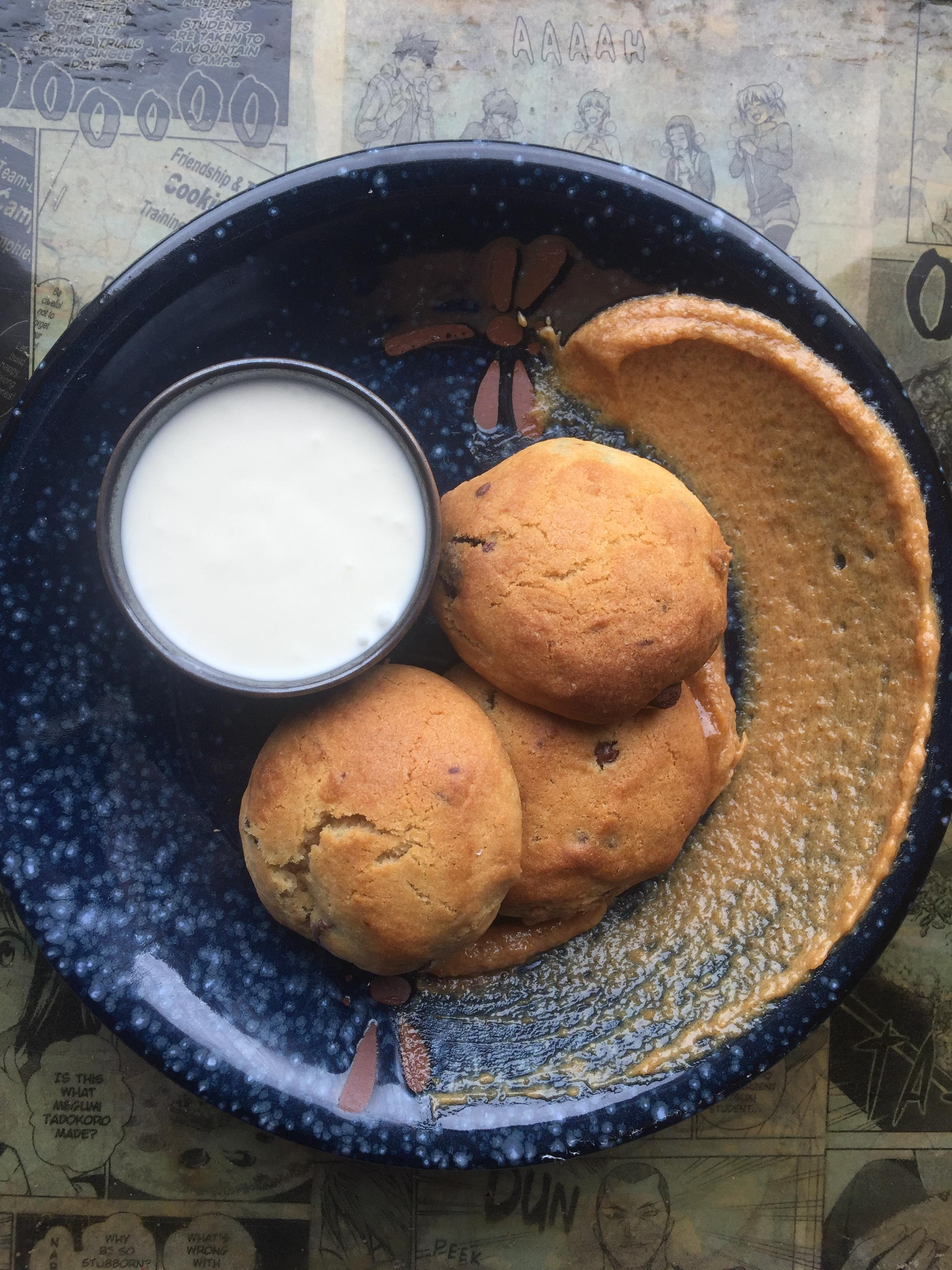 There's only one dessert on the menu: freshly baked chocolate chip cookies. The fetching rounds arrive with a pot of cream accented with cinnamon and a swipe of sweet-salty-savory red miso paste. (Image: Courtesy Toki Underground)<p></p>