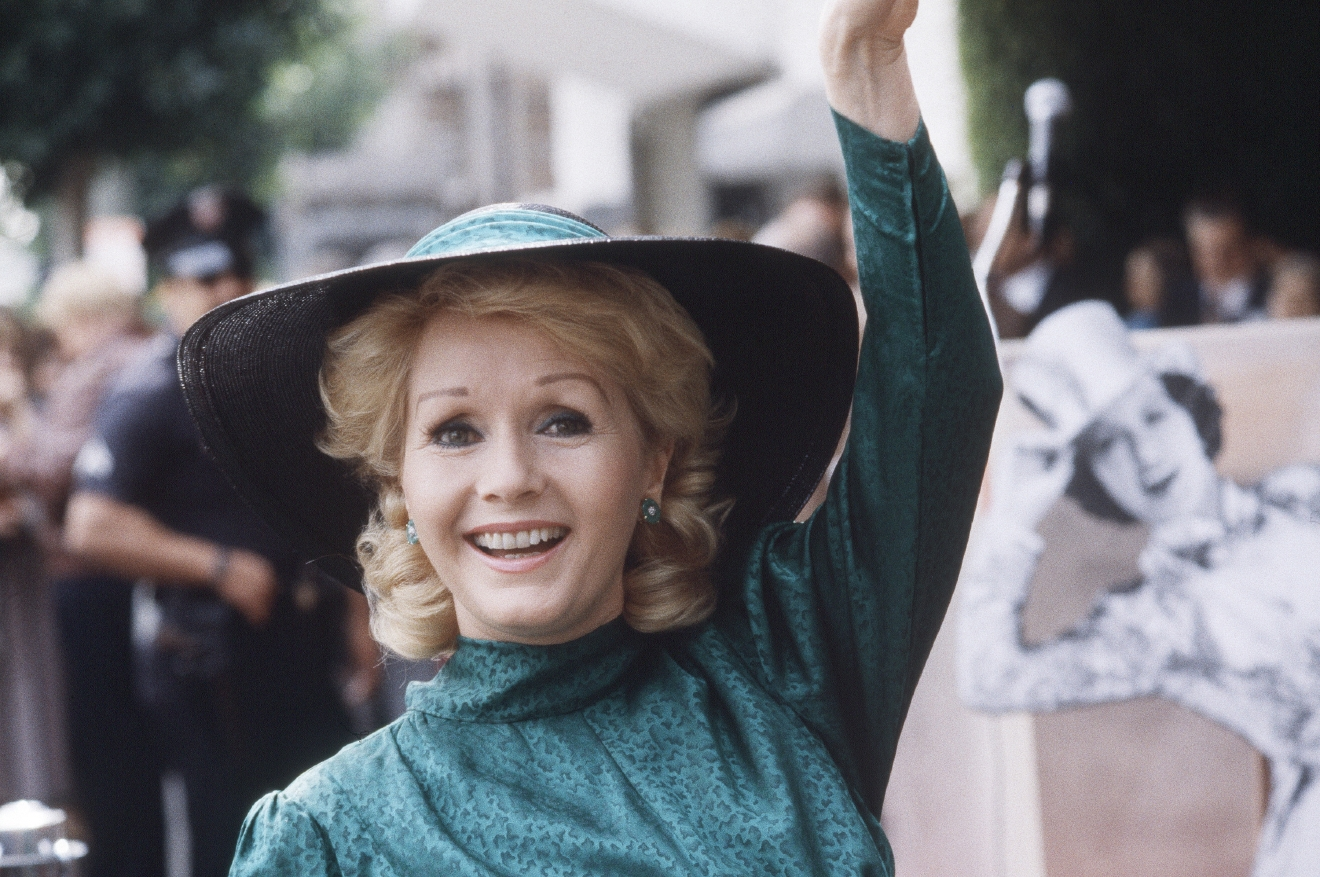 "FILE- In this Feb. 15, 1984, file photo, actress Debbie Reynolds appears at Hollywood Walk of Fame ceremonies in Los Angeles. Reynolds, star of the 1952 classic ""Singin' in the Rain"" died Wednesday, Dec. 28, 2016, according to her son Todd Fisher. She was 84. (AP Photo/Wally Fong, File)"