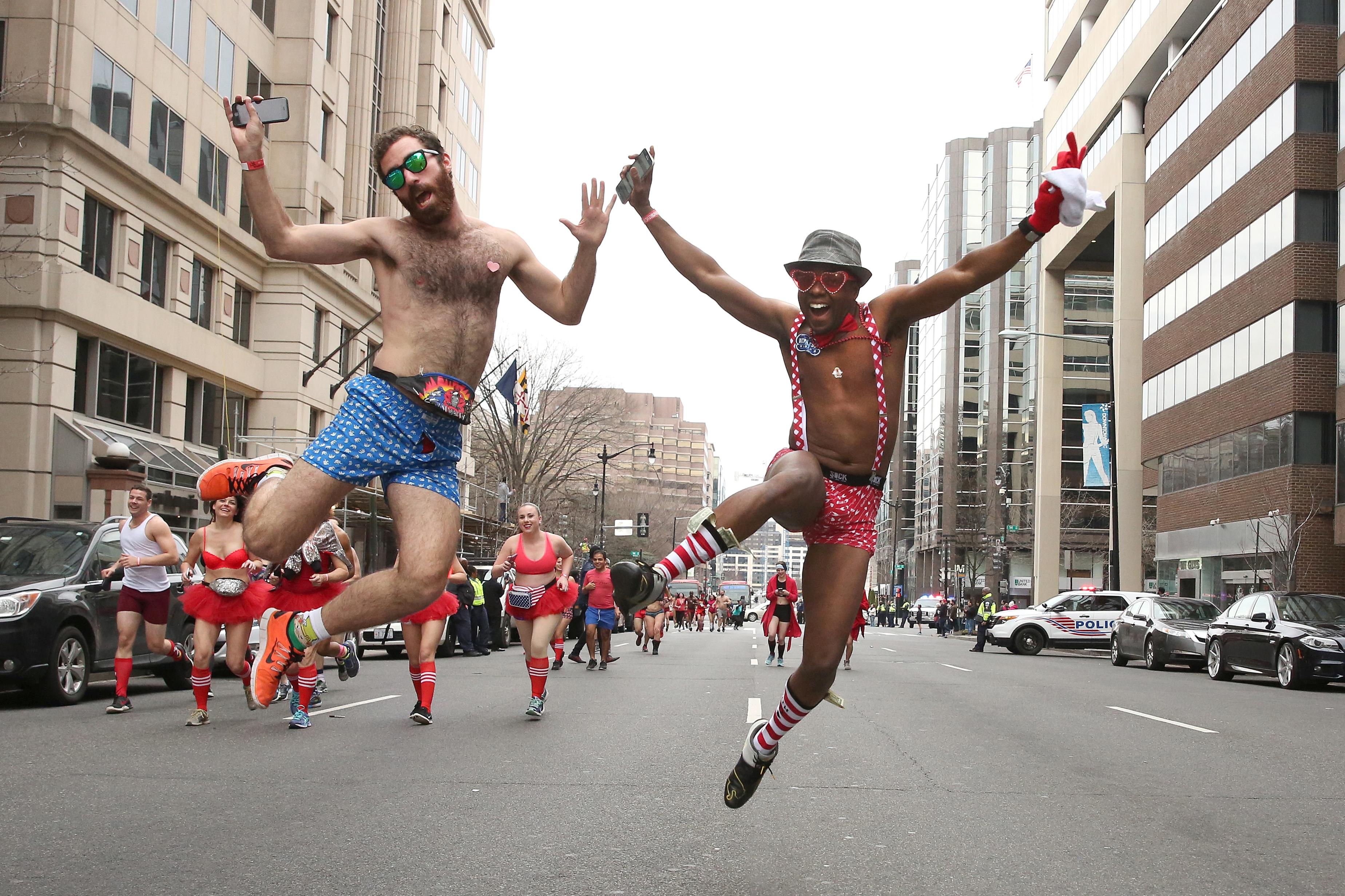 February, 2017. Two men leap in the air during Cupid's Undie Run.{&amp;nbsp;} (Amanda Andrade-Rhoades/DC Refined)<p></p>