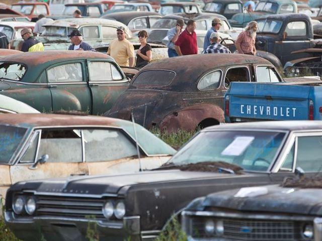 Potential bidders browse through some of about 500 vintage cars and trucks in the auction of former Lambrecht Chevrolet dealership vehicles in Pierce, Neb.