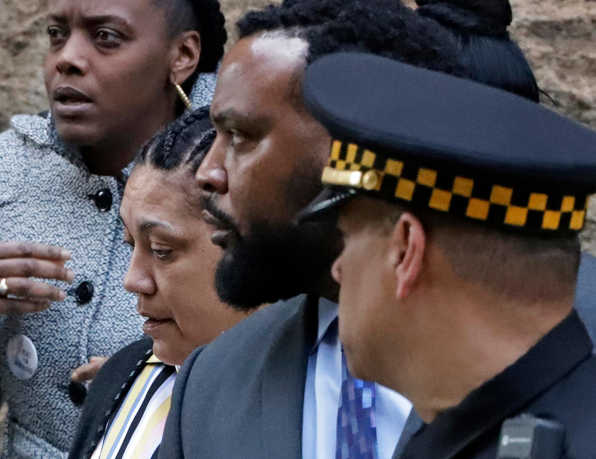 Michelle Kenney, second from left, the mother of Antwon Rose II, leaves the Allegheny County Courthouse with her lawyer S. Lee Merritt, center, after day two of the trial for Michael Rosfeld, a former police officer in East Pittsburgh, Pa., Wednesday, March 20, 2019. (AP Photo/Gene J. Puskar)