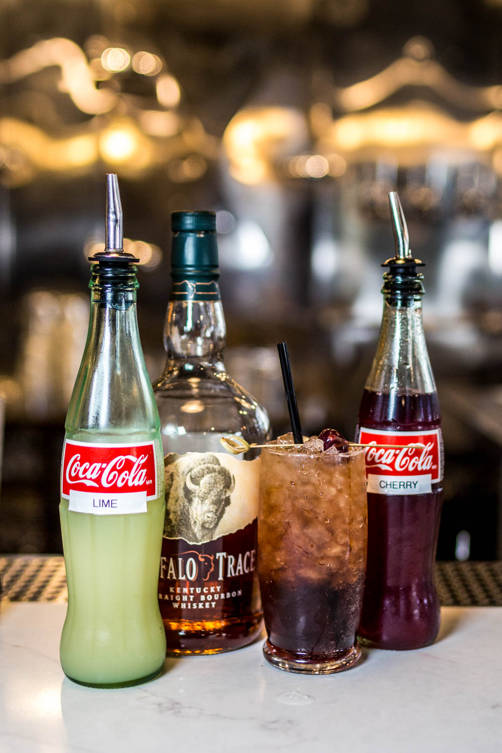 Cherry Coke: bourbon, can sugar cola, homemade cherry syrup, and fresh lime served in a highball over flaked ice / Image: Catherine Viox // Published: 10.17.19