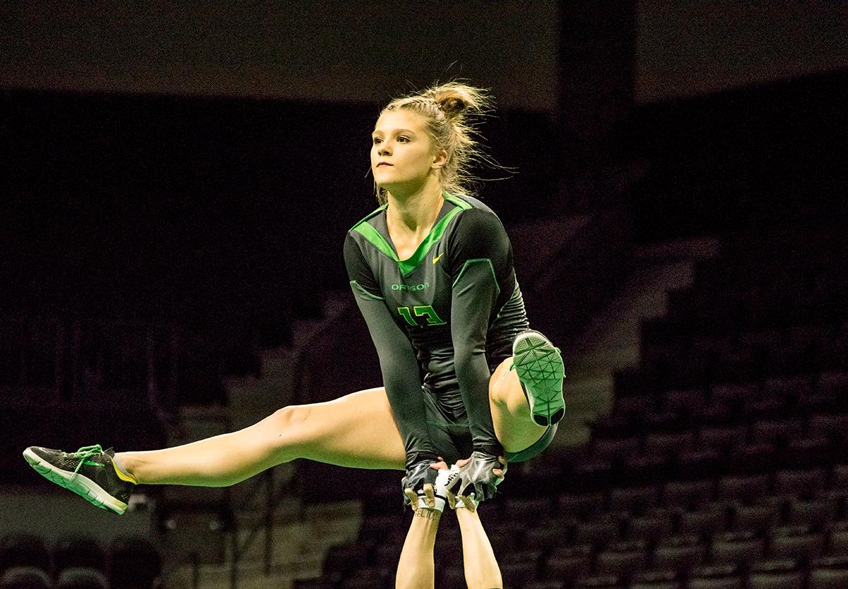 At their last home meet of the year and on Senior Night, the Ducks Acro and Tumbling Team defeated the Azusa Pacific Cougars, winning in all six categories: 38.70 to 37.20 in Compulsory; 29.35 to 28.60 in Acro; 29.40 to 29.35 in Pyramid; 29.35 to 28.95 in Toss; 57.525 to 66.15 in Tumbling; 103.75 to 98.03 in Team Routine; for an overall total of 288.08 to 277.28. The Ducks finished the season 6-1 and will next compete in the NCATA National Championship at Azusa, California April 27-29. Photo by Kezia Setyawan, Oregon News Lab