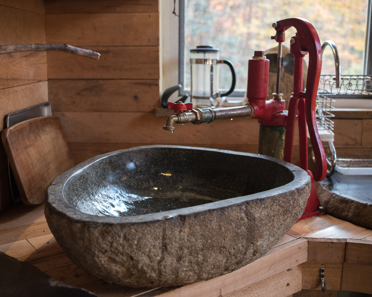 While there is no running water in the cabin, hand-pumps are available to draw well water up into the cabin. / Image: Phil Armstrong, Cincinnati Refined // Published: 11.14.17