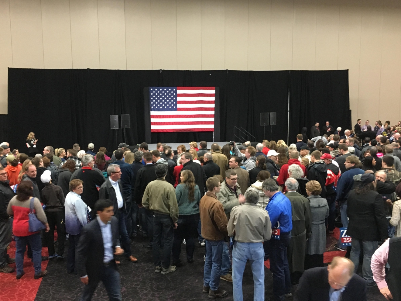 A crowd of people wait for Republican presidential candidate Ted Cruz to take the stage at the KI Convention Center in Green Bay. (WLUK/Andrew LaCombe)
