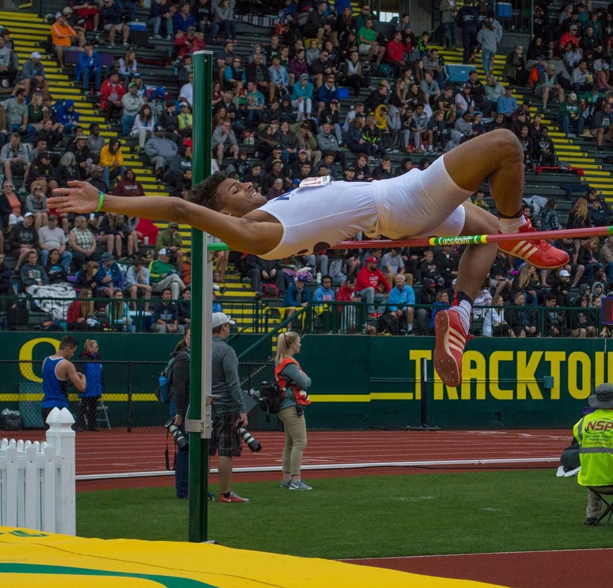 Tyler Hanrahan jumps to victory; clearing the height of 6-05.00, he wins the 4A Boys High Jump event at the OSAA Track and Field Championships at Hayward Field. Photo by Emily Gonzalez, Oregon News Lab.