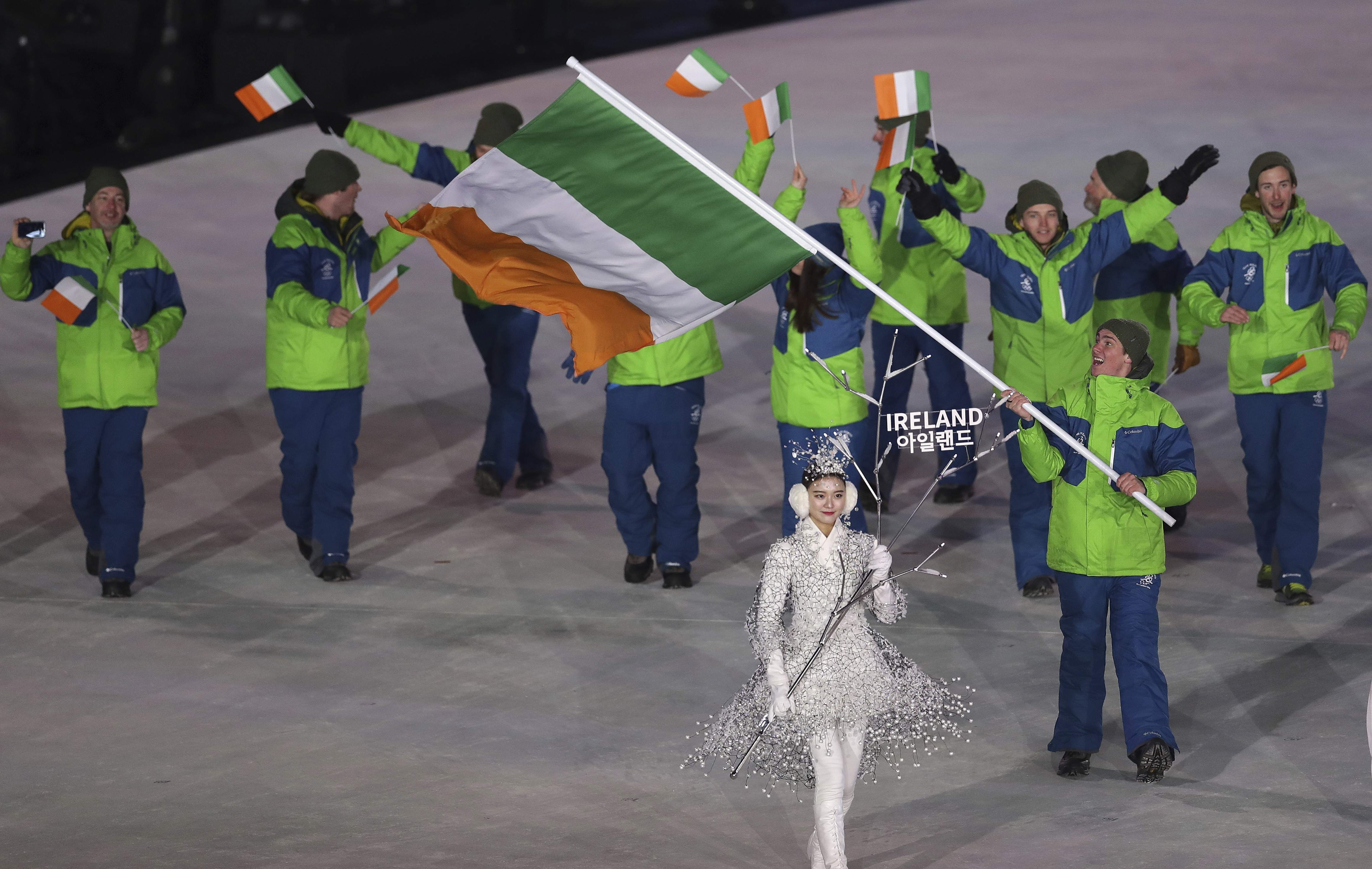 Seamus O'Connor carries the flag of Ireland during the opening ceremony of the 2018 Winter Olympics in Pyeongchang, South Korea, Friday, Feb. 9, 2018. (AP Photo/Michael Sohn)