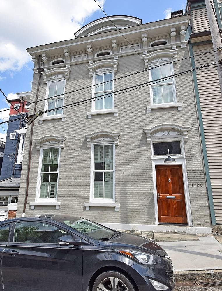 <p>1120 Fuller Street in Mt. Adams - $1,115,000 / This three-bedroom, four-bathroom, 5,330-square-foot beaut on Fuller Street in Mt. Adams has built-in shelves, shiny hardwood floors, a huge kitchen, several outdoor decks, and historic charm in the form of old fireplaces and painted, exposed brick. / Our favorite feature: It's gotta be that cute little outdoor patio under the shade of a tree. What a great spot for morning coffee in the spring and summer. / Image:{&nbsp;}Comey & Shepherd // Published: 1.9.20</p>