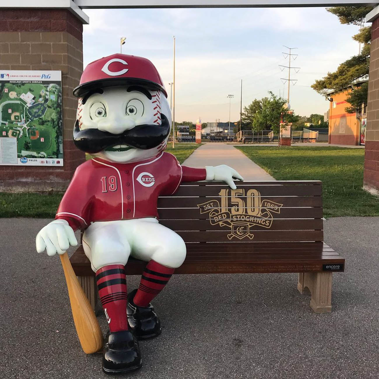 To celebrate the Reds' 150th Anniversary, 24 benches featuring Mr. Redlegs sculptures have been added to various spots around the area, as well as out of town locations including Dayton, Loveland, and Louisville, for the perfect Reds photo op. The mascot sports different uniforms from throughout the team's history at each of the benches. The Reds have been wearing these same throwback uniforms during their 2019 season. / Location: Reds Youth Academy / Uniform: 2019 / Image courtesy of Instagram user @cincinnat.ian   // Published: 5.14.19