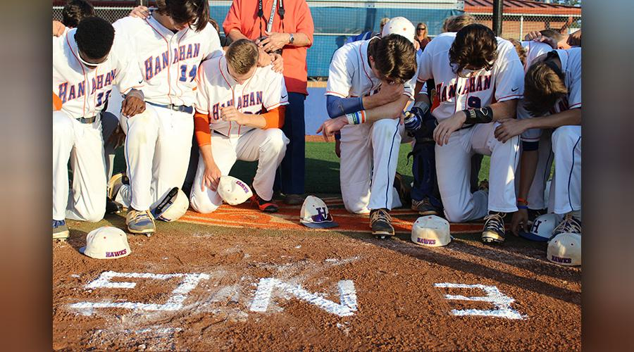 This photo taken during Monday night's game at Hanahan shows Emily Getman's initials painted in the dirt behind home plate. (Provided)