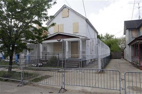 A 10-foot chain link fence surrounded the home of Ariel Castro in Cleveland in this May 14, 2013 file photo.
