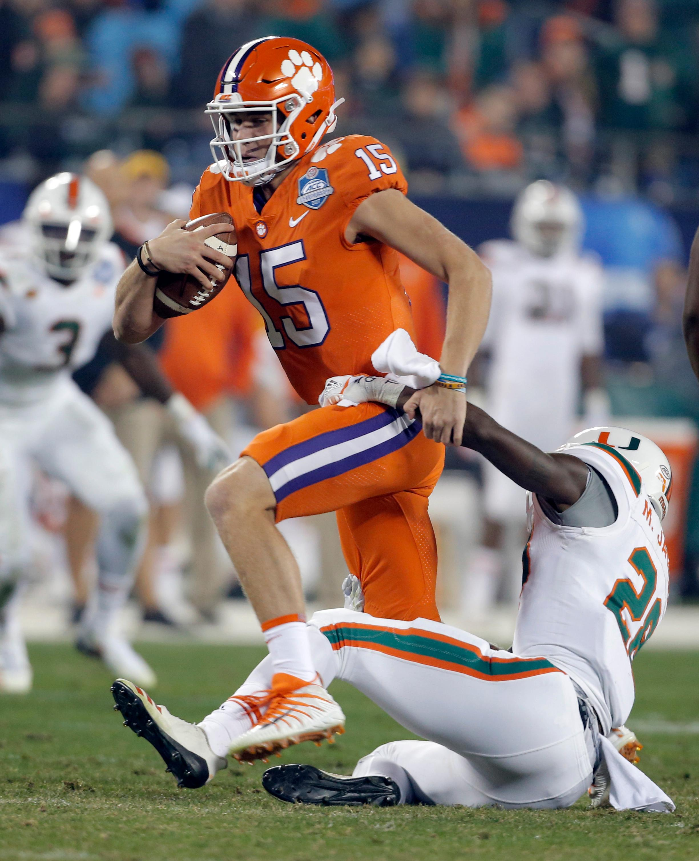 Clemson's Hunter Johnson (15) is sacked by Miami's Michael Jackson (28) during the second half of the Atlantic Coast Conference championship NCAA college football game in Charlotte, N.C., Saturday, Dec. 2, 2017. (AP Photo/Bob Leverone)