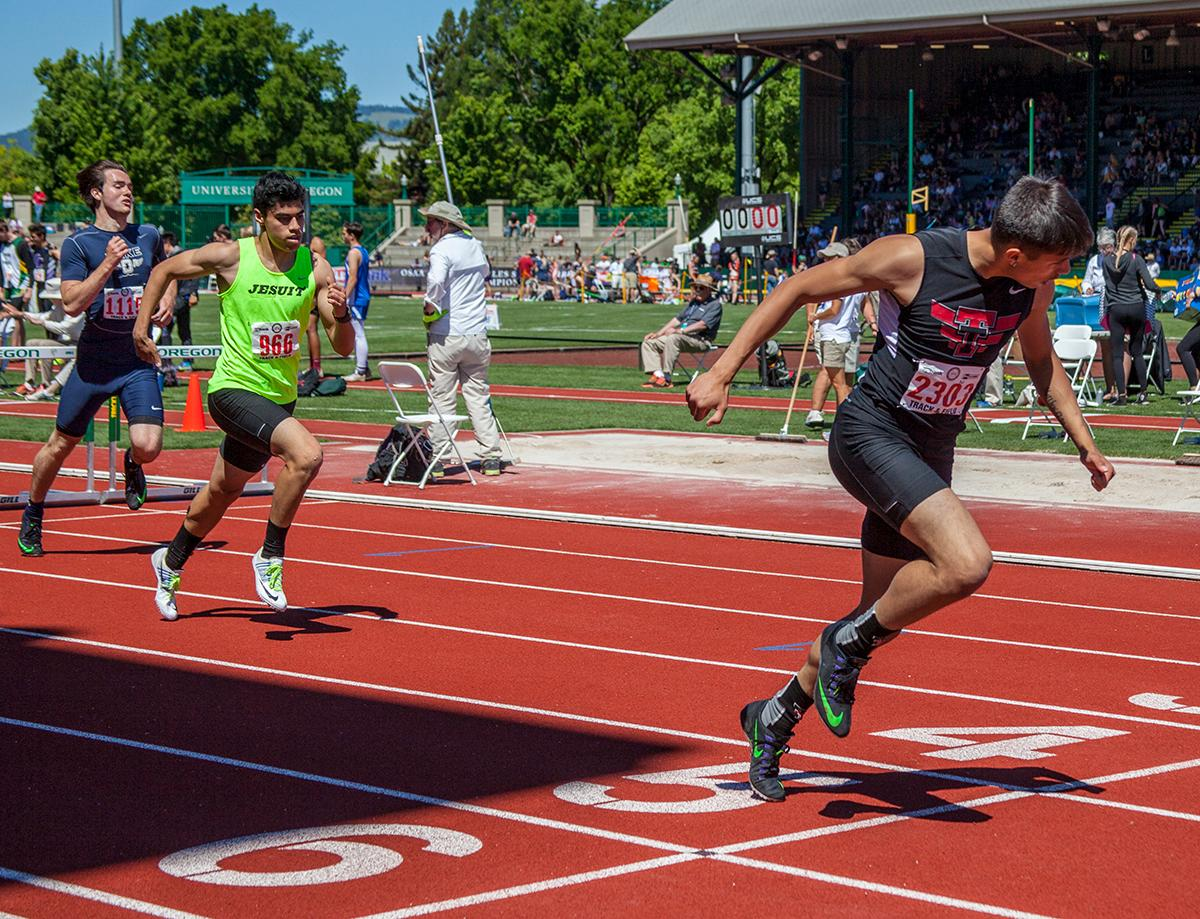 Ryan Cavinta from Tualatin High School wins Boys 300 Meter Hurdles 6A Prelims event with the time of 38.19 at the OSAA Track and Field State Championships at Hayward Field. Photo by Vannie Cooper, Oregon News Lab