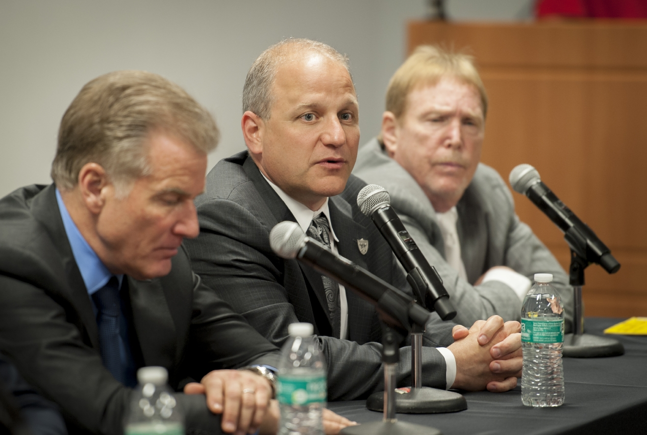 Mark Badain, center, president of the Oakland Raiders, is flanked by Rob Goldstein, left, president and COO of Las Vegas Sands, and Mark Davis, owner of the Oakland Raiders during a press conference following a meeting of the Southern Nevada Tourism Infrastructure Committee at the Stan Fulton Building, UNLV on Thursday, April 28, 2016.  (Mark Damon/Las Vegas News Bureau)
