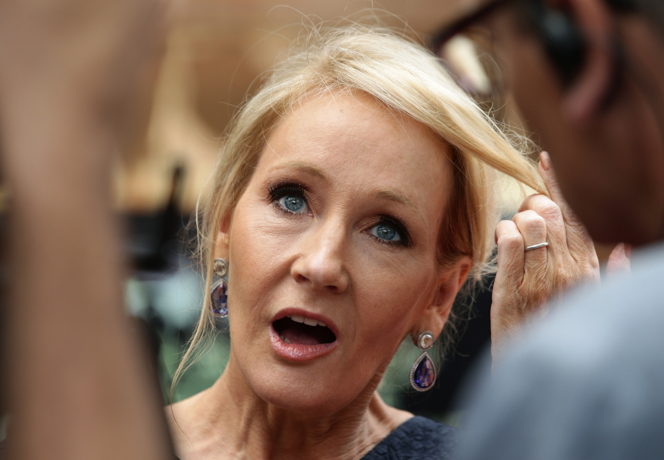 Writer J.K. Rowling arrives at gala performance of Harry Potter and the Cursed Child, at the Palace Theatre in central London, Saturday, July 30, 2016. (Yui Mok/PA via AP)