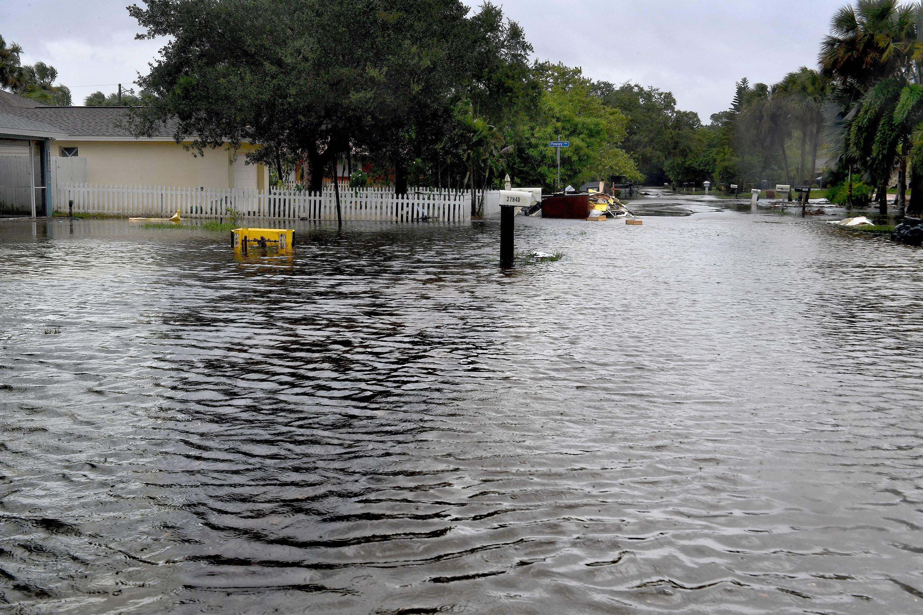 Many streets in the Bonita Springs, Florida, area were flooded by mid-morning on Sunday. MUST CREDIT: Washington Post photo by Michael S. Williamson