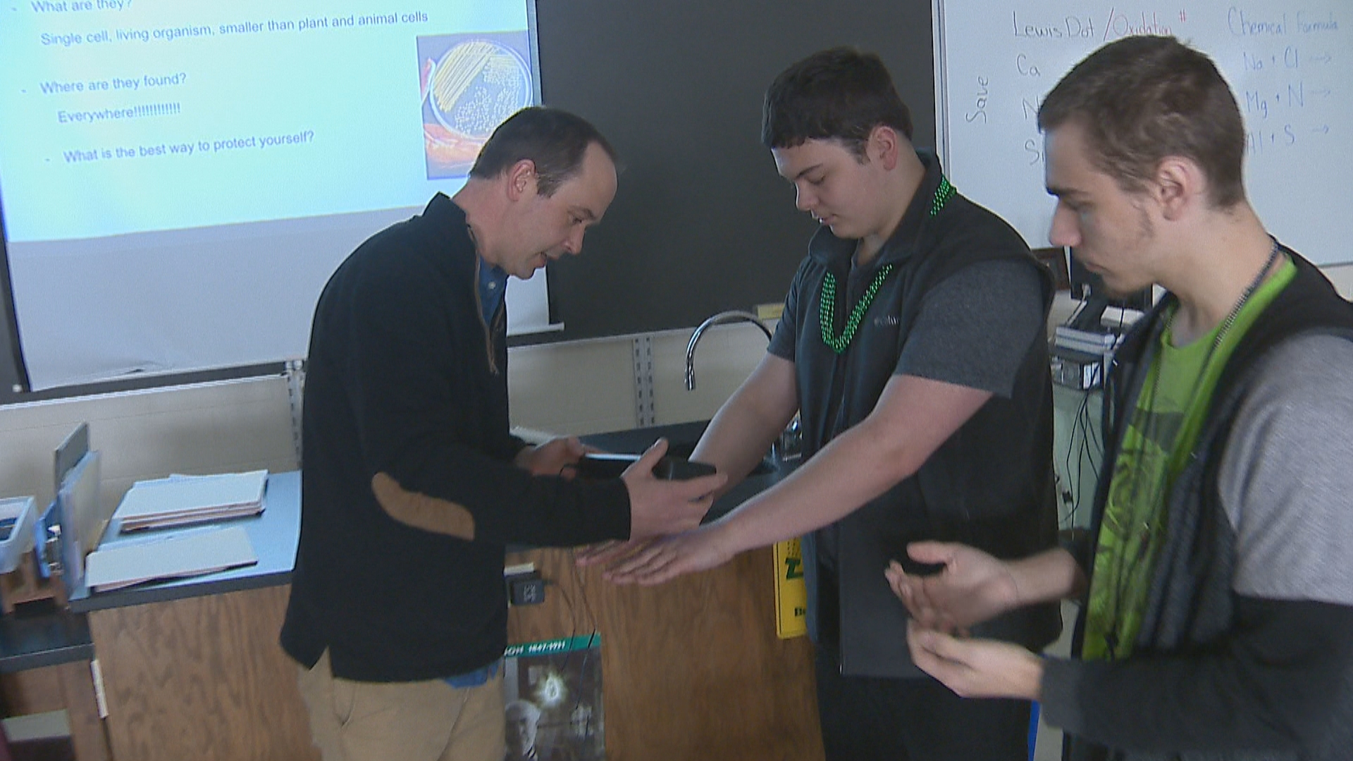 Stephen Engels, a biology teacher at Green Bay Southwest High School does a demonstration with students during class. (WLUK)