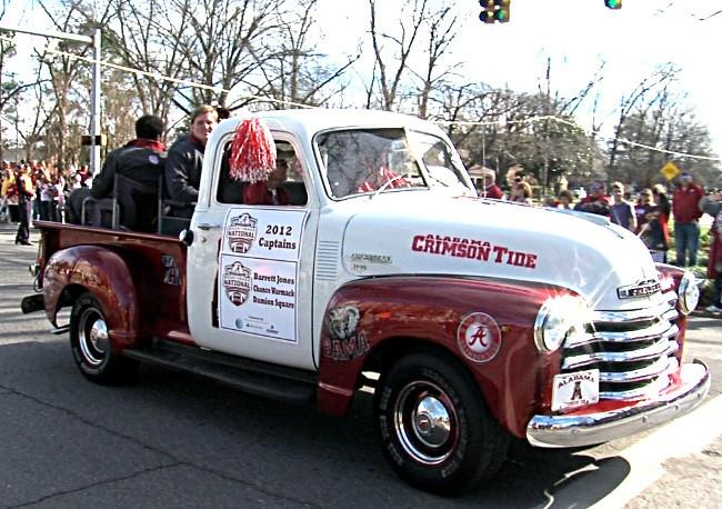 Alabama seniors Barrett Jones, Chance Warmack and Damion Square rode in a custom, vintage truck for the BCS Championship parade on Saturday, January 19, 2013.