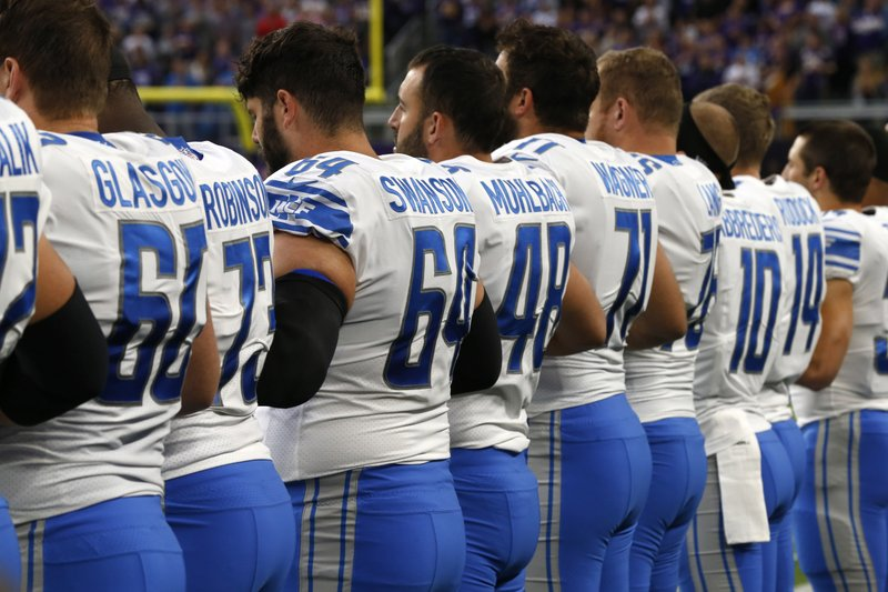 Detroit Lions players lock arms during the playing of the national anthem before an NFL football game against the Minnesota Vikings, Sunday, Oct. 1, 2017, in Minneapolis. (AP Photo/Jim Mone)