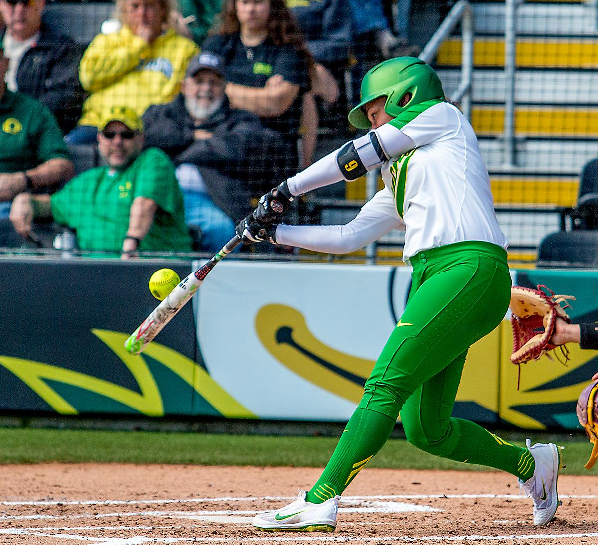 The Duck's Shannon Rhodes (#9) hits the ball up and out of bounds. The Oregon Ducks Softball team took their third win over the Arizona Sun Devils, 1-0, in the final game of the weekends series that saw the game go into an eighth inning before the Duck?s Mia Camuso (#7) scored a hit allowing teammate Haley Cruse (#26) to run into home plate for a point. The Ducks are now 33-0 this season and will next play a double header against Portland State on Tuesday, April 4 at Jane Sanders Stadium. Photo by August Frank, Oregon News Lab