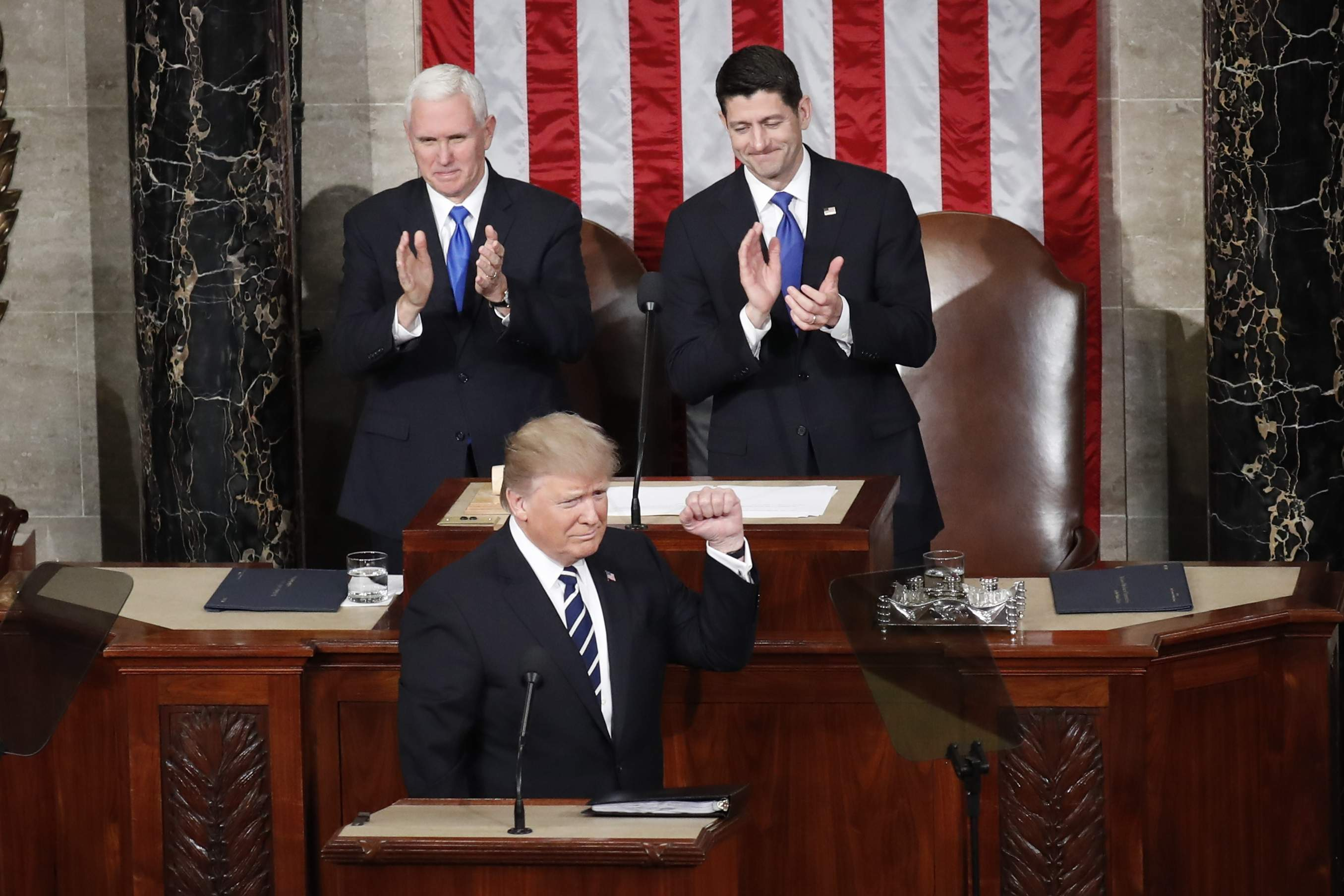 DAY 40 - In this Feb. 28, 2017, file photo, President Donald Trump, flanked by Vice President Mike Pence and House Speaker Paul Ryan of Wis., gestures on Capitol Hill in Washington, before his address to a joint session of Congress. (AP Photo/Pablo Martinez Monsivais, file)