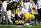 Green Bay Packers quarterback Aaron Rodgers (12) is attended to by medical staff after being hit by Minnesota Vikings outside linebacker Anthony Barr (55) in the first half of a game in Minneapolis, Sunday, Oct. 15, 2017.