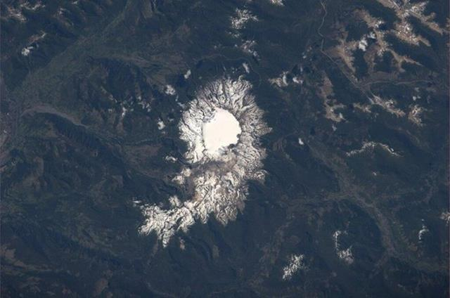 Sollipulli Volcano, Chile. One of the many earth observation sites that we are tasked to take pics of each day (Photo & Caption: Mike Hopkins, NASA)