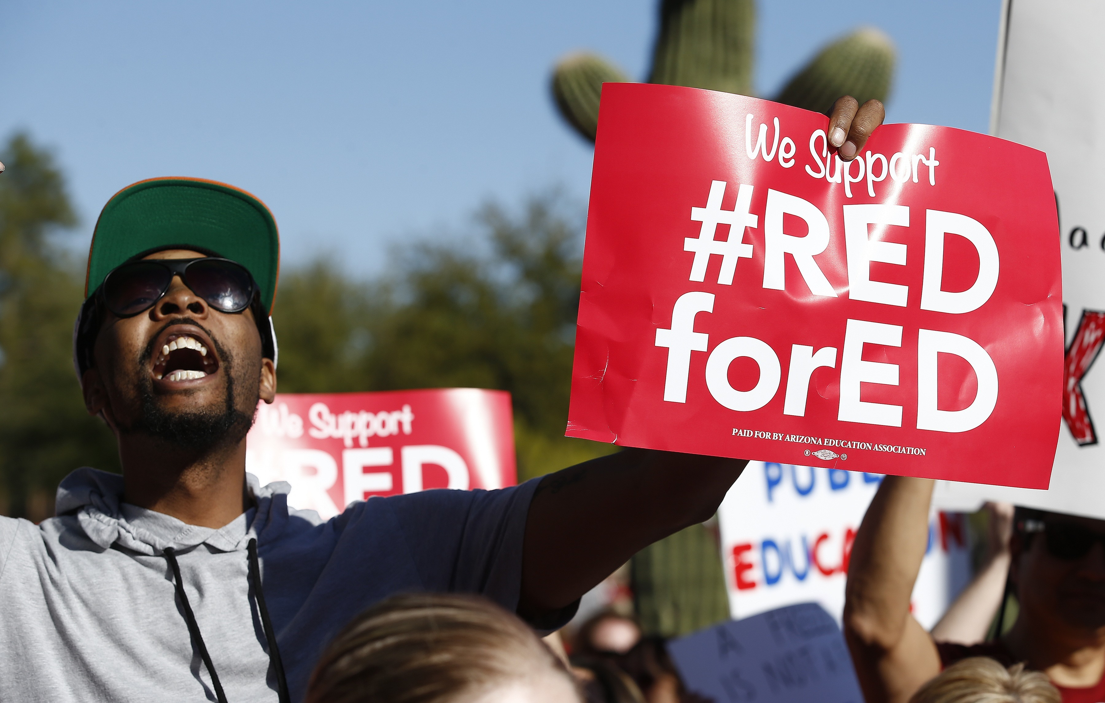 Arizona teachers and education advocates shouts as they march at the Arizona Capitol highlighting low teacher pay and school funding Wednesday, March 28, 2018, in Phoenix. (AP Photo/Ross D. Franklin)