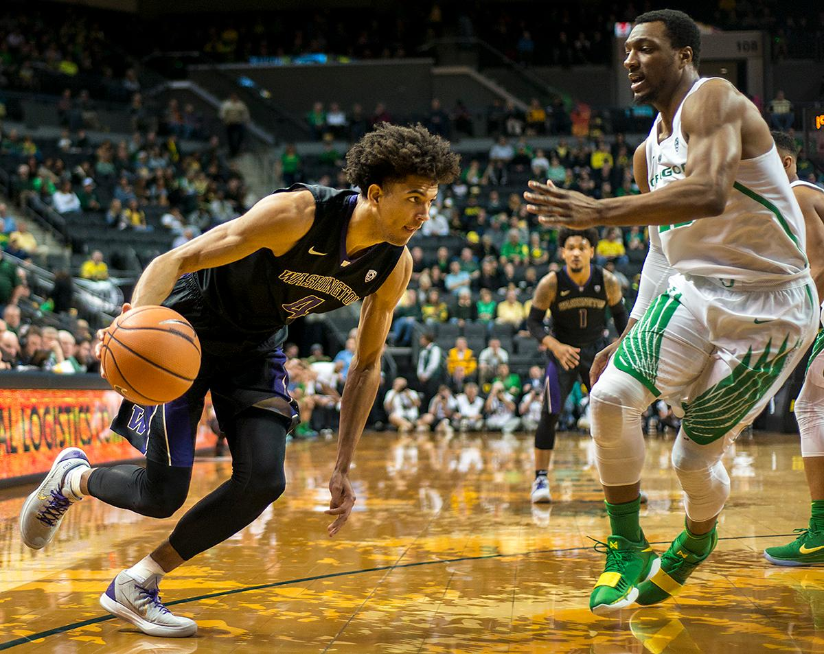 Washington Huskies guard Matisse Thybulle (#4) makes a low and hard drive for the basket. The Oregon Ducks defeated the Washington Huskies 65-40 on Thursday night at Matthew Knight Arena. Troy Brown, Junior led Oregon with 21 points to match his career high, and Kenny Wooten set a career best of seven shots blocked. The Ducks now stand 6-5 in the Pac-12 conference play. Photo by Abigail Winn, Oregon News Lab