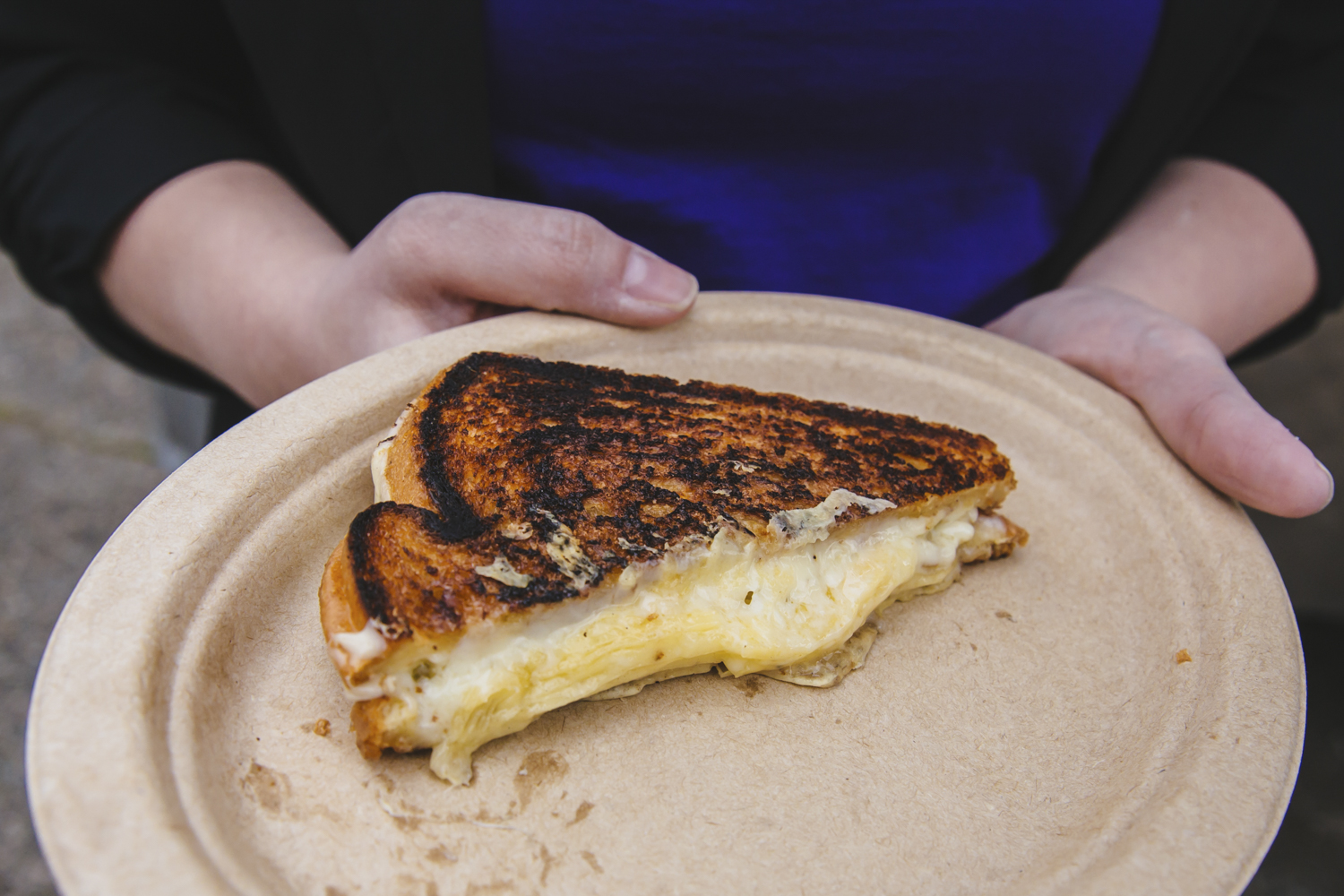 <p>&quot;The White Cheddar Royale&quot; from the Bread and Circuses Food truck:  Truffle Duck Fat Butter, Darigold White Cheddar, Brioche. Seattle's annual Grilled Cheese Grand Prix event kicked off this weekend, properly celebrating April as National Grilled Cheese Month. We went, obviously (for work....) and here were the juiciest sammies on the block we could find. The good news? Pretty much all of these come from brick and mortar stores you can find any time in the city - not just April, and not just t the Grand Prix. (Image: Sunita Martini / Seattle Refined)</p>